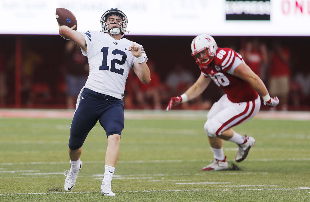 Brigham Young Cougars quarterback Tanner Magnum (12) throws the winning touchdown against Nebraska in Lincoln, NE Saturday, Sept. 5, 2015. BYU won 33-28.