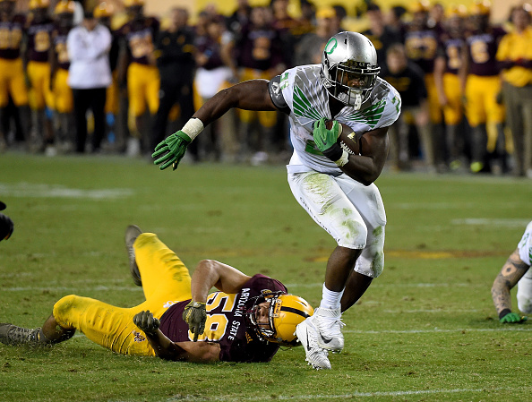 TEMPE, AZ - OCTOBER 29:  Royce Freeman #21 of the Oregon Ducks scores a touchdown during overtime against the Arizona State Sun Devils at Sun Devil Stadium on October 29, 2015 in Tempe, Arizona. Ducks won 61-55. (Photo by Norm Hall/Getty Images)