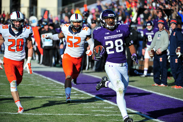 EVANSTON, IL - NOVEMBER 29: Justin Jackson #28 of the Northwestern Wildcats runs against the Illinois Fighting Illini during the second half on November 29, 2014 at Ryan Field in Evanston, Illinois.  The Illinois Fighting Illini defeated the Northwestern Wildcats 47-33.  (Photo by David Banks/Getty Images)