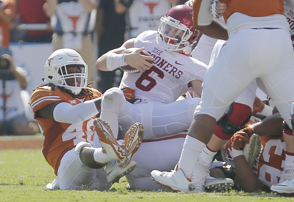 Texas linebacker Malik Jefferson (46) sacks Oklahoma quarteback Baker Mayfield (6) during the first half at the Cotton Bowl in Dallas on Saturday, Oct. 10, 2015. Texas won, 24-17. (Brandon Wade/Fort Worth Star-Telegram/TNS via Getty Images)