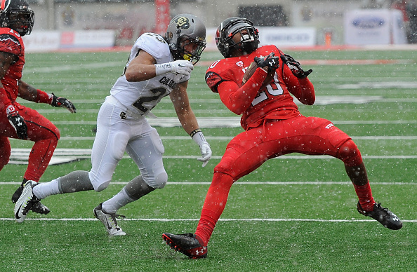SALT LAKE CITY, UT - NOVEMBER 28: Free safety Marcus Williams #20 of the Utah Utes intercepts a pass in front tailback Phillip Lindsay #23 of the Colorado Buffaloes in the first quarter at Rice- Eccles Stadium on November 28, 2015 in Salt Lake City, Utah. (Photo by Gene Sweeney Jr/Getty Images)