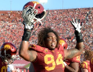 LOS ANGELES, CA - AUGUST 30:  Defensive end Leonard Williams #94 of the USC Trojans celebrates his interception during the second quarter against the Fresno State Bulldogs at Los Angeles Memorial Coliseum on August 30, 2014 in Los Angeles, California.  (Photo by Harry How/Getty Images)