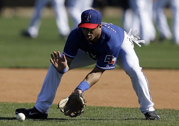 :SURPRISE, AZ - MARCH 03: Russell Wilson #3 of the Texas Rangers runs through some infield drills during a work out before the game against the Cleveland Indians at Surprise Stadium on March 03, 2014 in Surprise, Arizona. (Photo by Mike McGinnis/Getty Images)