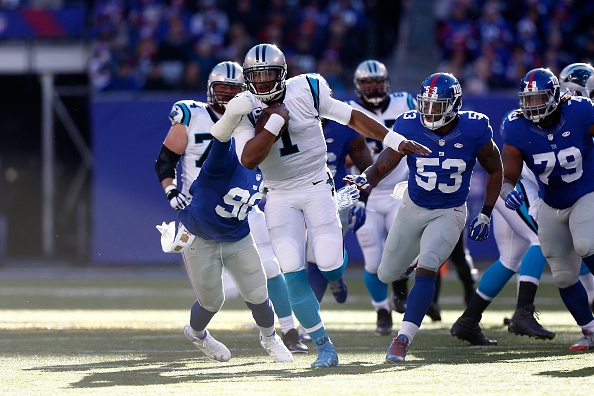 EAST RUTHERFORD, NJ - DECEMBER 20:  Cam Newton #1 of the Carolina Panthers runs the ball in the first quarter against the New York Giants during their game at MetLife Stadium on December 20, 2015 in East Rutherford, New Jersey.  (Photo by Jeff Zelevansky/Getty Images)