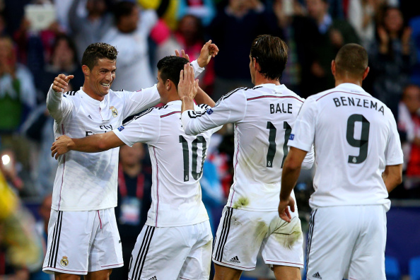 CARDIFF, WALES - AUGUST 12:  (L-R) Cristiano Ronaldo of Real Madrid celebrates with teammates James Rodriguez, Gareth Bale and Karim Benzema after scoring the opening goal during the UEFA Super Cup between Real Madrid and Sevilla FC at Cardiff City Stadium on August 12, 2014 in Cardiff, Wales.  (Photo by Clive Mason/Getty Images)