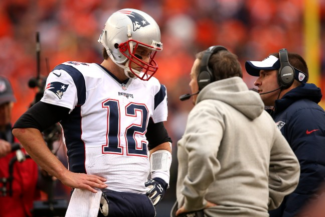 DENVER, CO - JANUARY 24: Tom Brady #12 of the New England Patriots speaks to head coach Bill Belichick in the fourth quarter against the Denver Broncos in the AFC Championship game at Sports Authority Field at Mile High on January 24, 2016 in Denver, Colorado.  (Photo by Doug Pensinger/Getty Images)