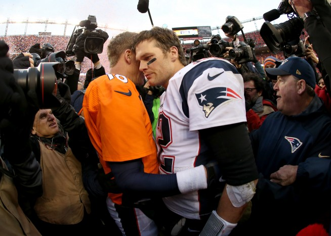 DENVER, CO - JANUARY 24:  Peyton Manning #18 of the Denver Broncos and Tom Brady #12 of the New England Patriots speak after the AFC Championship game at Sports Authority Field at Mile High on January 24, 2016 in Denver, Colorado. The Broncos defeated the Patriots 20-18. (Photo by Doug Pensinger/Getty Images)