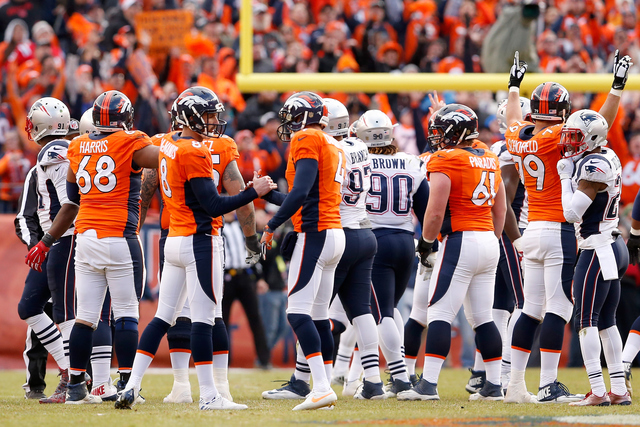 DENVER, CO - JANUARY 24:  Brandon McManus #8 of the Denver Broncos celebrates with  Britton Colquitt #4 after a 52-yard field goal in the second quarter against the New England Patriots in the AFC Championship game at Sports Authority Field at Mile High on January 24, 2016 in Denver, Colorado.  (Photo by Christian Petersen/Getty Images)