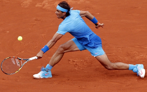 Rafael Nadal of Spain in action against Quentin Halys of France during their first round match for the French Open tennis tournament at Roland Garros in Paris, France, 26 May 2015.  EPA/YOAN VALAT