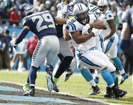 Carolina Panthers running back Jonathan Stewart (28) runs into the end zone for a touchdown against Seattle Seahawks free safety Earl Thomas (29) during the first half of an NFL divisional playoff football game, Sunday, Jan. 17, 2016, in Charlotte, N.C. (AP Photo/Bob Leverone)