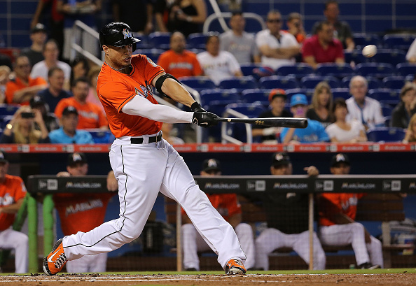 MIAMI, FL - JUNE 14: Giancarlo Stanton #27 of the Miami Marlins hits during a game against the Colorado Rockies at Marlins Park on June 14, 2015 in Miami, Florida.  (Photo by Mike Ehrmann/Getty Images)