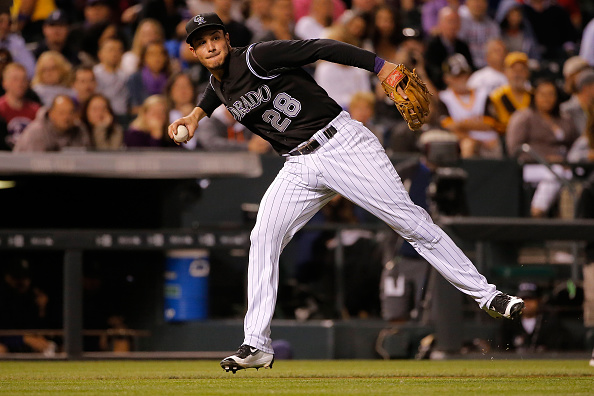 DENVER, CO - SEPTEMBER 18:  Third baseman Nolan Arenado #28 of the Colorado Rockies fields a sacrifice bunt by Ian Kennedy #22 of the San Diego Padres in the fourth inning at Coors Field on September 18, 2015 in Denver, Colorado.  (Photo by Doug Pensinger/Getty Images)