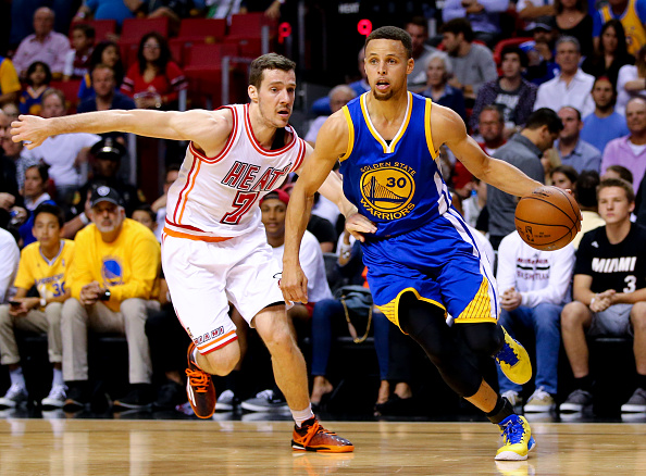 MIAMI, FL - FEBRUARY 24: Stephen Curry #30 of the Golden State Warriors drives past Goran Dragic #7 of the Miami Heat during the game at the American Airlines Arena on February 24, 2016 in Miami, Florida.  NOTE TO USER: User expressly acknowledges and agrees that, by downloading and or using this photograph, User is consenting to the terms and conditions of the Getty Images License Agreement. (Photo by Rob Foldy/Getty Images)