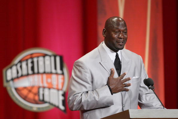 SPRINGFIELD, MA - SEPTEMBER 11: Michael Jordan reacts during his induction into the Naismith Memorial Basketball Hall of Fame on September 11, 2009 in Springfield, Massachusetts. NOTE TO USER: User expressly acknowledges and agrees that, by downloading and or using this Photograph, user is consenting to the terms and conditions of the Getty Images License Agreement.(Photo by Jim Rogash/Getty Images)