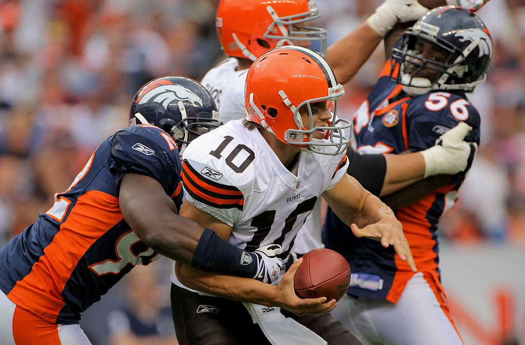 DENVER - SEPTEMBER 20:  Quarterback Brady Quinn #10 of the Cleveland Browns is sacked by defensive end Elvis Dumervil #92 of the Denver Broncos as linebacker Robert Ayers looks to help out in the fourth quarter during NFL action at Invesco Field at Mile High on September 20, 2009 in Denver, Colorado. The Broncos defeated the Browns 27-6.  (Photo by Doug Pensinger/Getty Images)