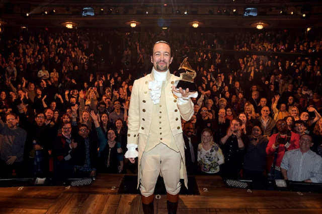 """LOS ANGELES, CA - FEBRUARY 15:  Composer, actor Lin-Manuel Miranda celebrates GRAMMY award on stage  during """"Hamilton"""" GRAMMY performance for The 58th GRAMMY Awards at Richard Rodgers Theater on February 15, 2016 in Los Angeles City.  (Photo by Theo Wargo/WireImage)"""