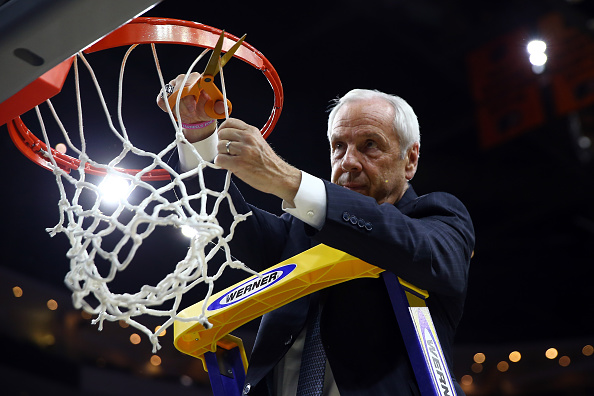 PHILADELPHIA, PA - MARCH 27:  Head coach Roy Williams of the North Carolina Tar Heels celebrates by cutting down the net after defeating the Notre Dame Fighting Irish with a score of 74 to 88 in the 2016 NCAA Men's Basketball Tournament East Regional Final at Wells Fargo Center on March 27, 2016 in Philadelphia, Pennsylvania.  (Photo by Elsa/Getty Images)