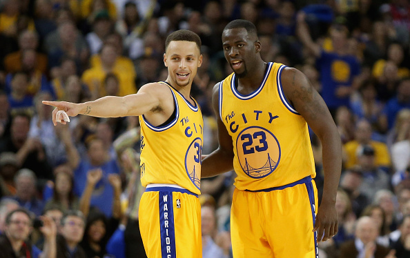 OAKLAND, CA - MARCH 29:  Stephen Curry #30 talks to Draymond Green #23 of the Golden State Warriors during their game against the Washington Wizards at ORACLE Arena on March 29, 2016 in Oakland, California. NOTE TO USER: User expressly acknowledges and agrees that, by downloading and or using this photograph, User is consenting to the terms and conditions of the Getty Images License Agreement.  (Photo by Ezra Shaw/Getty Images)