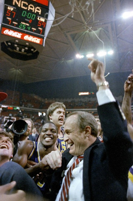 Dale Brown celebrates after making history with LSU in 1986.