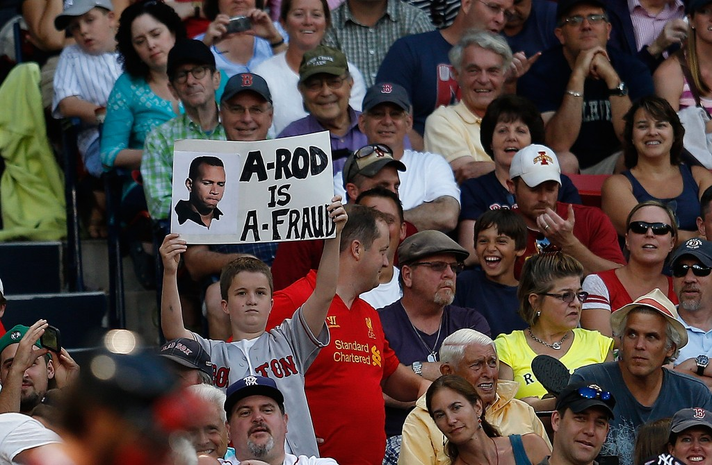 BOSTON, MA - AUGUST 17:  A fan holds a sign critical of Alex Rodriguez #13 of the New York Yankees during a game with the Boston Red Sox at Fenway Park on August 17, 2013 in Boston, Massachusetts. (Photo by Jim Rogash/Getty Images)
