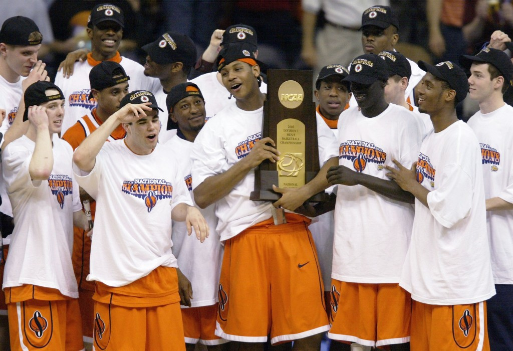 NEW ORLEANS - APRIL 7:  Carmelo Anthony #15 and the rest of the Syracuse team celebrate with the championship trophy after defeating Kansas 81-78 during the championship game of the NCAA Men's Final Four Tournament on April 7, 2003 at the Louisiana Superdome in New Orleans, Louisiana.  Anthony was named the tournaments most outstanding player.  (Photo by Andy Lyons/Getty Images)