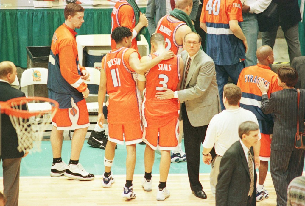 Head coach Jim Boeheim of Syracuse consoles his players #11 Elimu Nelson and #3 Lazarus Sims at the end of the 1996 NCAA Men''s Basketball Championship at the Continental Air Arena in East Rutherford, New Jersey.