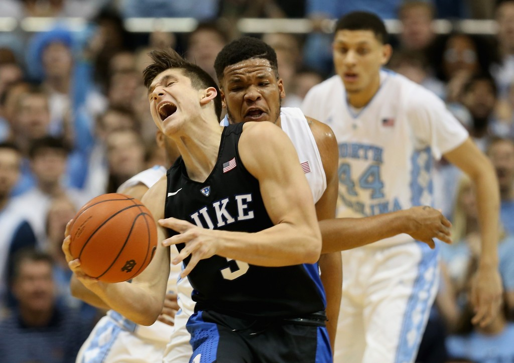 CHAPEL HILL, NC - FEBRUARY 17:  Grayson Allen #3 of the Duke Blue Devils is hit by Kennedy Meeks #3 of the North Carolina Tar Heels during their game at Dean Smith Center on February 17, 2016 in Chapel Hill, North Carolina.  (Photo by Streeter Lecka/Getty Images)