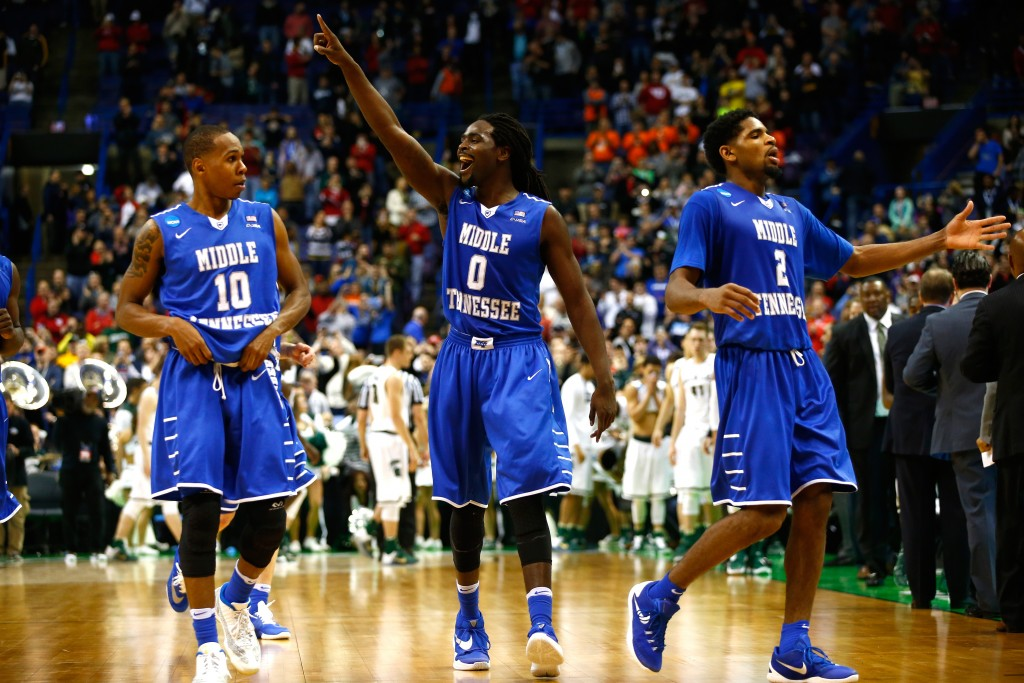 ST LOUIS, MO - MARCH 18: Darnell Harris #0 of the Middle Tennessee Blue Raiders celebrates with teammates late in the game against the Michigan State Spartans during the first round of the 2016 NCAA Men's Basketball Tournament at Scottrade Center on March 18, 2016 in St Louis, Missouri.  (Photo by Jamie Squire/Getty Images)