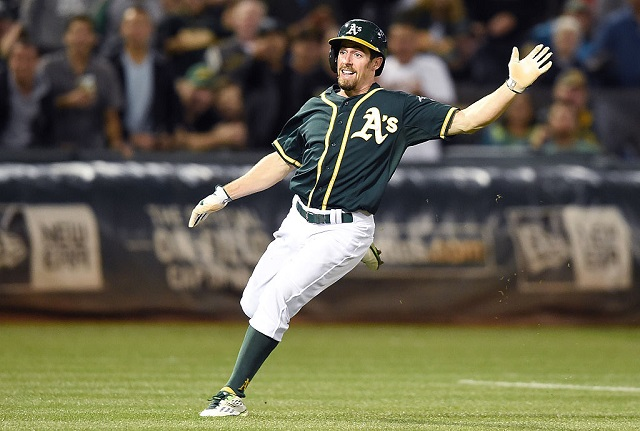 OAKLAND, CA - SEPTEMBER 23: Billy Burns #1 of the Oakland Athletics puts on the brakes between third base and home against the Texas Rangers in the bottom of the fifth inning at O.co Coliseum on September 23, 2015 in Oakland, California. Burns returned to third base for a triple setting a new team record of 41 triples for a season. (Photo by Thearon W. Henderson/Getty Images)