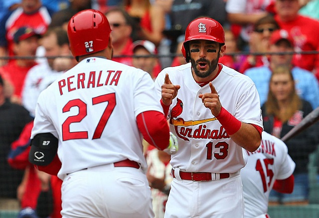 ST. LOUIS, MO - MAY 31: Matt Carpenter #13 of the St. Louis Cardinals congratulates Jhonny Peralta #27 of the St. Louis Cardinals after Peralta hits a two-run home run against the Los Angeles Dodgers in the first inning at Busch Stadium on May 31, 2015 in St. Louis, Missouri. (Photo by Dilip Vishwanat/Getty Images)