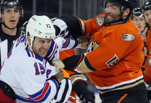 NEW YORK, NY - DECEMBER 22: Tanner Glass #15 of the New York Rangers fights with Patrick Maroon #19 of the Anaheim Ducks during the first period at Madison Square Garden on December 22, 2015 in New York City. (Photo by Bruce Bennett/Getty Images)