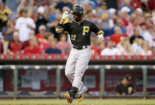 CINCINNATI, OH - SEPTEMBER 08: Andrew McCutchen #22 of the Pittsburgh Pirates celebrates at home plate after hitting a three run home run in the third inning during the game against the Cincinnati Reds at Great American Ball Park on September 8, 2015 in Cincinnati, Ohio. (Photo by Andy Lyons/Getty Images)