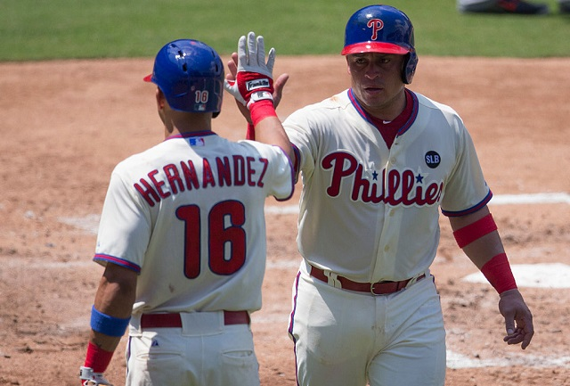 PHILADELPHIA, PA - JULY 19: Cesar Hernandez #16 and Carlos Ruiz #51 of the Philadelphia Phillies high five after Ruiz scored a run in the bottom of the second inning against the Miami Marlins on July 19, 2015 at the Citizens Bank Park in Philadelphia, Pennsylvania. The Phillies defeated the Marlins 8-7. (Photo by Mitchell Leff/Getty Images)