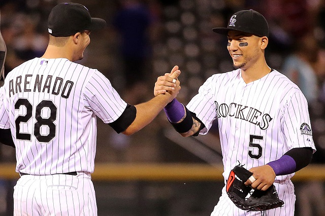 DENVER, CO - SEPTEMBER 04: Nolan Arenado #28 and Carlos Gonzalez #5 of the Colorado Rockies celebrate their victory over the San Francisco Giants at Coors Field on September 4, 2015 in Denver, Colorado. Arenado and Gonzalez had back to back solo home runs off of Chris Heston #53 of the San Francisco Giants in the first inning as the Rockies defeated the Giants 2-1. (Photo by Doug Pensinger/Getty Images)