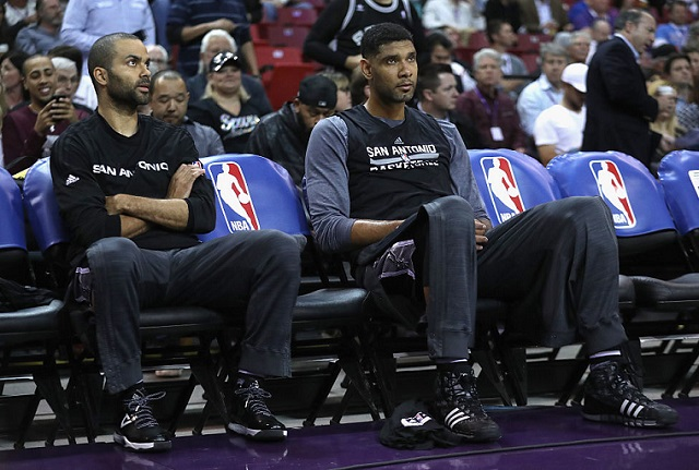 SACRAMENTO, CA - FEBRUARY 24: Tim Duncan #21 and Tony Parker #9 of the San Antonio Spurs sits on the bench before their game against the Sacramento Kings at Sleep Train Arena on February 24, 2016 in Sacramento, California. (Photo by Ezra Shaw/Getty Images)