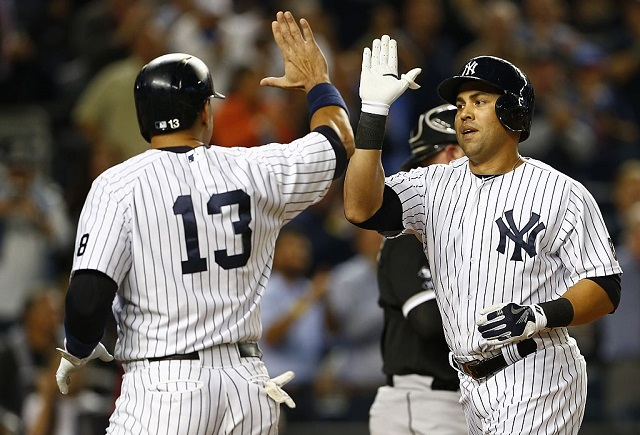 NEW YORK, NY - SEPTEMBER 24: Carlos Beltran #36 of the New York Yankees is congratulated by teammate Alex Rodriguez #13 after hitting a three-run home run against the Chicago White Sox during the third inning of a MLB baseball game at Yankee Stadium on September 24, 2015 in the Bronx borough of New York City. (Photo by Rich Schultz/Getty Images)