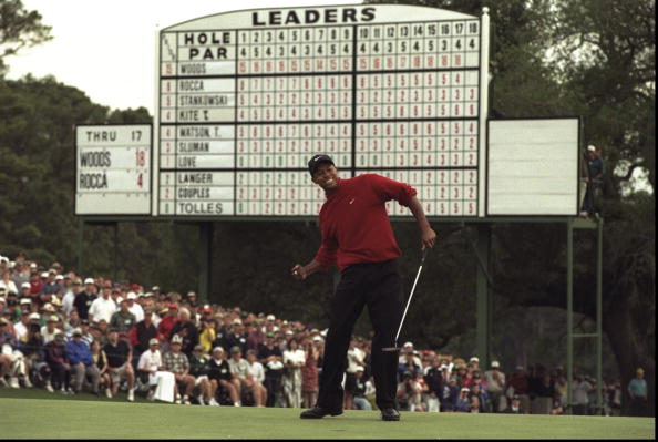 13 Apr 1997: Tiger Woods of the USA celebrates after sinking a 4 feet putt to win the US Masters at Augusta, Georgia. Woods won the tournament with a record low score of 18 under par.  Mandatory Credit: Stephen Munday /Allsport