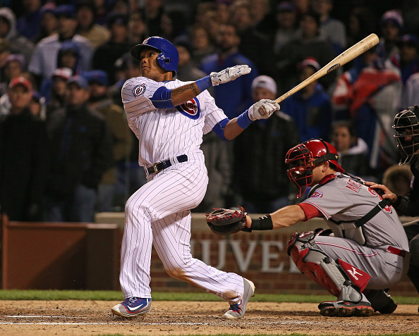 CHICAGO, IL - APRIL 11:  Addison Russell #27 of the Chicago Cubs hits a three-run home run in the 8th inning against the Cincinnati Reds during the home opener at Wrigley Field on April 11, 2016 in Chicago, Illinois.  (Photo by Jonathan Daniel/Getty Images)