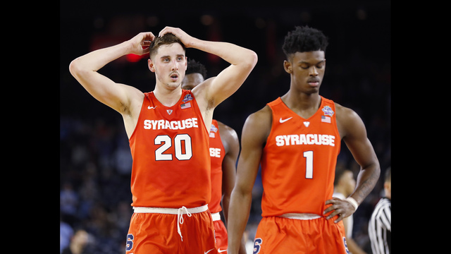 Syracuse's Tyler Lydon (20) and Franklin Howard (1) walks toward the bench during the second half of the NCAA Final Four tournament college basketball semifinal game against North Carolina Saturday, April 2, 2016, in Houston. North Carolina won 83-66.(AP Photo/Eric Gay)