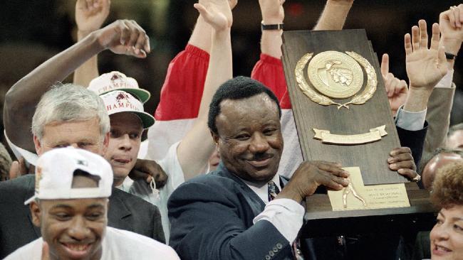 Nolan-Richardson-Holding-NCAA-Trophy