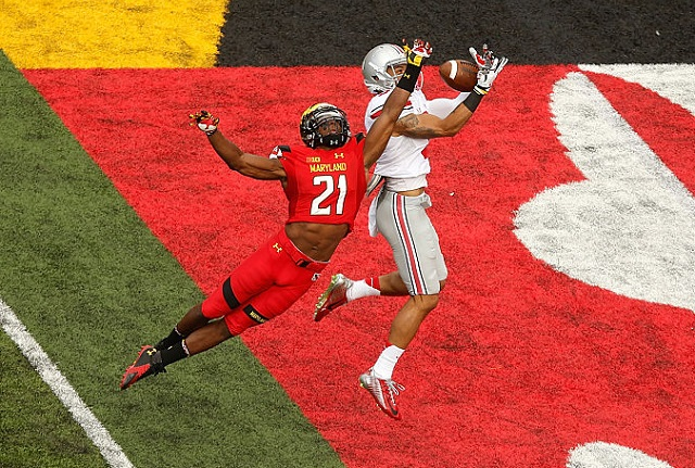 COLLEGE PARK, MD - OCTOBER 04:  Wide receiver Devin Smith #9 (R) of the Ohio State Buckeyes catches a touchdown pass against safety Sean Davis #21 of the Maryland Terrapins in the third quarter of Ohio State's 52-24 win at Byrd Stadium on October 4, 2014 in College Park, Maryland.  (Photo by Jonathan Ernst/Getty Images)