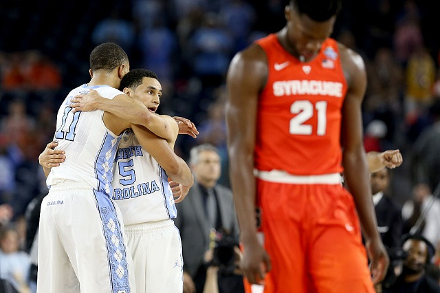 HOUSTON, TEXAS - APRIL 02: Brice Johnson #11 of the North Carolina Tar Heels and Marcus Paige #5 celebrate defeating the Syracuse Orange 83-66 as Tyler Roberson #21 of the Syracuse Orange reacts after the NCAA Men's Final Four Semifinal at NRG Stadium on April 2, 2016 in Houston, Texas. (Photo by Streeter Lecka/Getty Images)