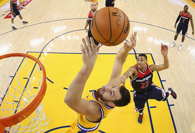 OAKLAND, CA - MARCH 29: Andrew Bogut #12 of the Golden State Warriors goes up for a shot against Otto Porter Jr. #22 of the Washington Wizards at ORACLE Arena on March 29, 2016 in Oakland, California. (Photo by Ezra Shaw/Getty Images)