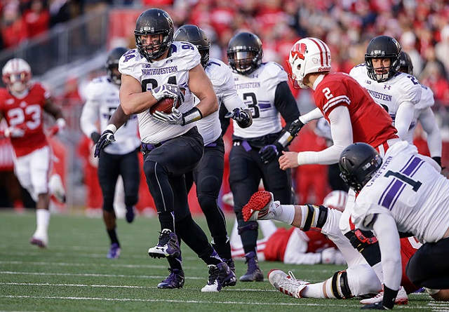 MADISON, WI - NOVEMBER 21: Northwestern Wildcats Dean Lowry #94 returns a fumble against the Wisconsin Badgers on November 21, 2015 at Camp Randall Stadium in Madison, Wisconsin. (Photo by Tom Lynn/Getty Images)
