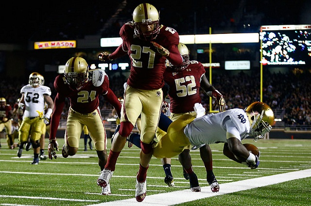 CHESTNUT HILL, MA - NOVEMBER 10: Justin Simmons #27 of the Boston College Eagles knocks down Theo Reddick #6 of the Notre Dame Fighting Irish to the ground on the end line during the game on November 10, 2012 at Alumni Stadium in Chestnut Hill, Massachusetts.  (Photo by Jared Wickerham/Getty Images)