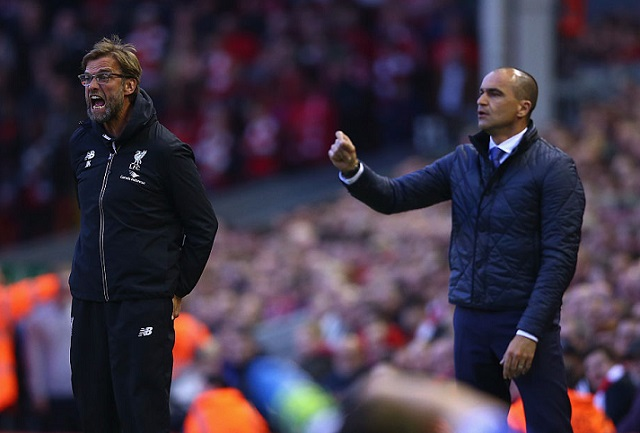 LIVERPOOL, ENGLAND - APRIL 20: Jurgen Klopp, manager of Liverpool and Roberto Martinez Manager of Everton look on during the Barclays Premier League match between Liverpool and Everton at Anfield, April 20, 2016, Liverpool, England (Photo by Clive Brunskill/Getty Images)