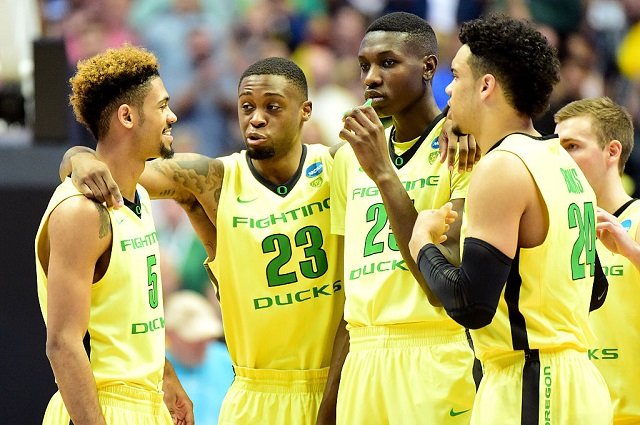 ANAHEIM, CA - MARCH 26: Tyler Dorsey #5, Elgin Cook #23, Chris Boucher #25, Casey Benson #2 and Dillon Brooks #24 of the Oregon Ducks huddle while taking on the Oklahoma Sooners in the NCAA Men's Basketball Tournament West Regional Final at Honda Center on March 26, 2016 in Anaheim, California. (Photo by Harry How/Getty Images)