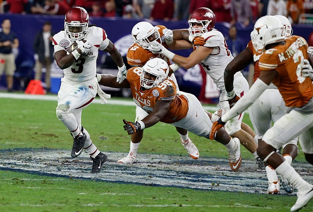 HOUSTON, TX - DECEMBER 29:  Tyrone Swoopes #18 of the Texas Longhorns drops back to pass in the first half of their game against the Arkansas Razorbacks at the AdvoCare V100 Texas Bowl at NRG Stadium on December 29, 2014 in Houston, Texas.  (Photo by Scott Halleran/Getty Images) *** Local Caption *** Tyrone Swoopes