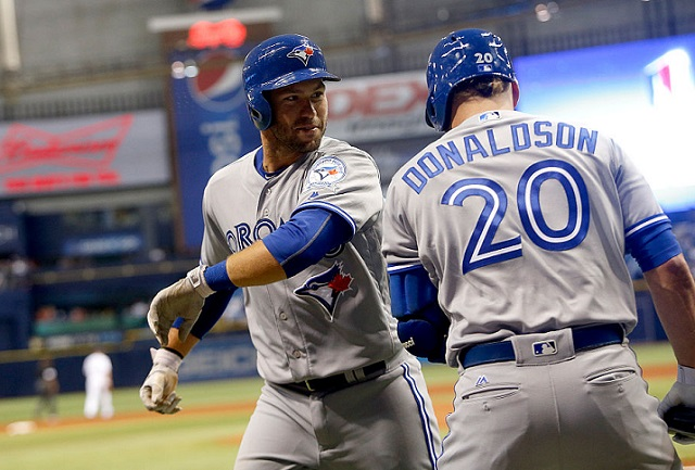 ST. PETERSBURG, FL - APRIL 4:  Josh Thole #22 of the Toronto Blue Jays celebrates with teammate Josh Donaldson #20 as he makes his way to the dugout after hitting a home run off of Drew Smyly of the Tampa Bay Rays during the third inning of a game on April 4, 2016 at Tropicana Field in St. Petersburg, Florida.  (Photo by Brian Blanco/Getty Images) *** Local Caption *** Josh Thole; Josh Donaldson
