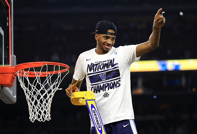 HOUSTON, TEXAS - APRIL 04: Mikal Bridges #25 of the Villanova Wildcats cuts the net after defeating the North Carolina Tar Heels 77-74 to win the 2016 NCAA Men's Final Four National Championship game at NRG Stadium on April 4, 2016 in Houston, Texas. (Photo by Ronald Martinez/Getty Images)